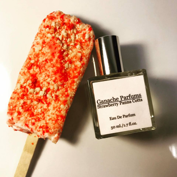 Ganache Parfums Strawberry Panna Cotta fragrance next to a strawberry ice cream bar