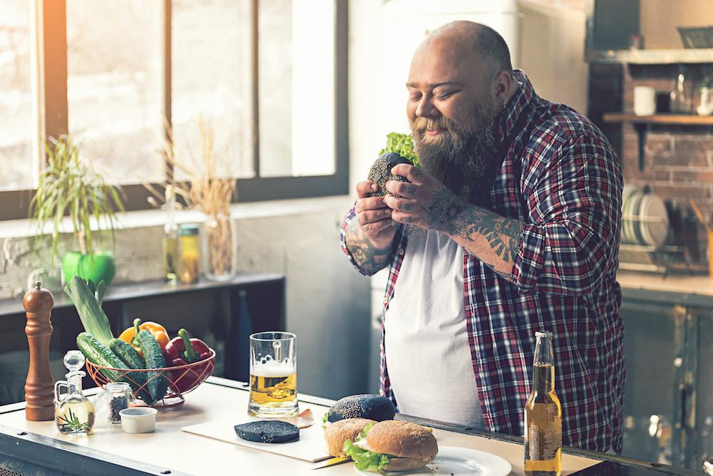 Man smelling his sandwich
