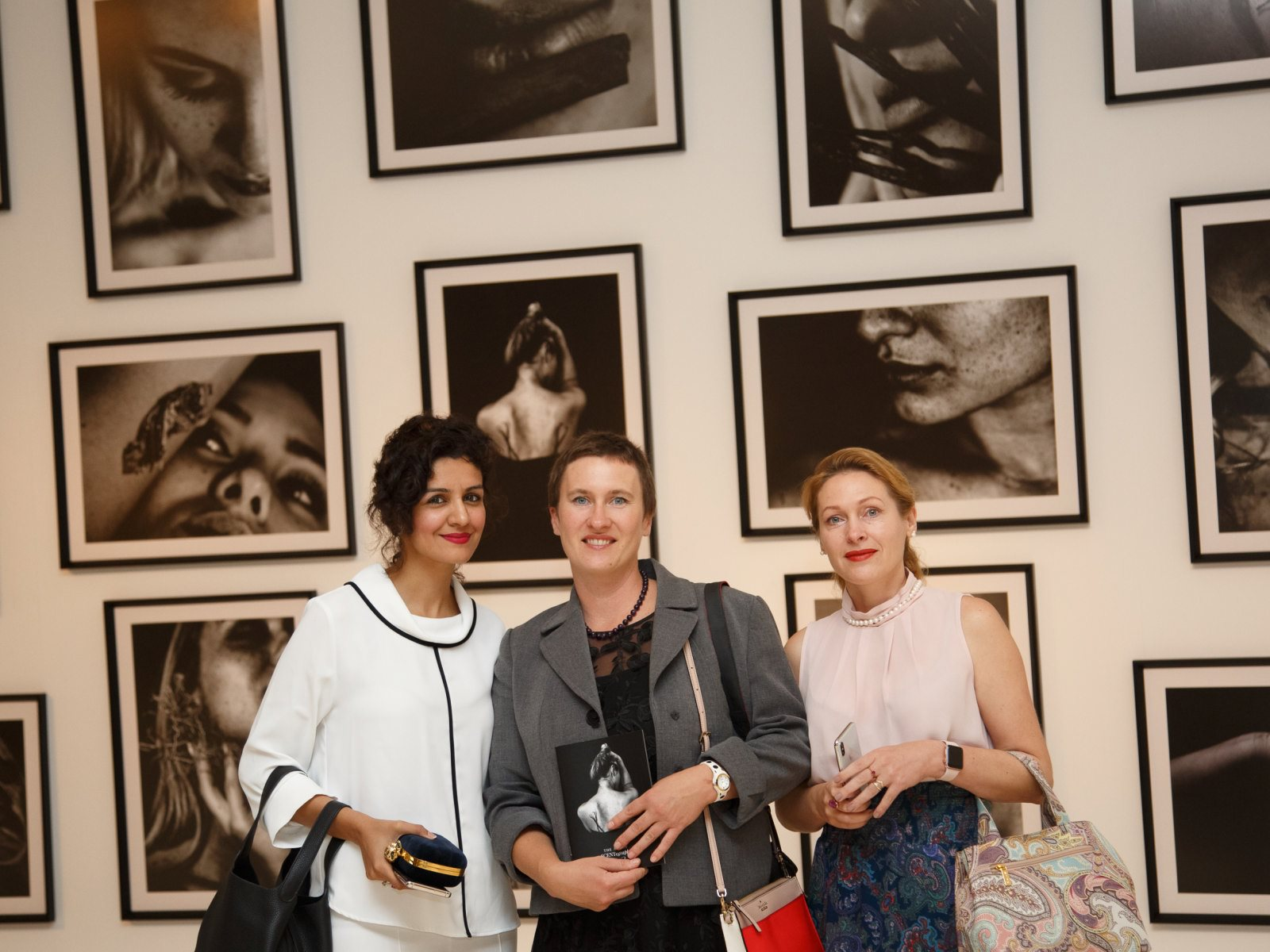 Samreen Shah, Elena and Svetlana with photos on background