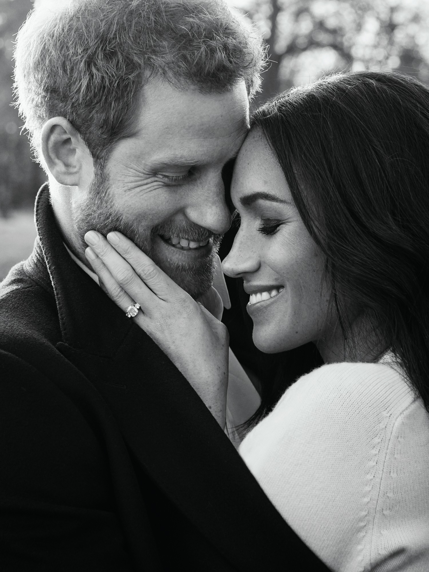Prince Harry and Meghan Markle hugging engagement photo