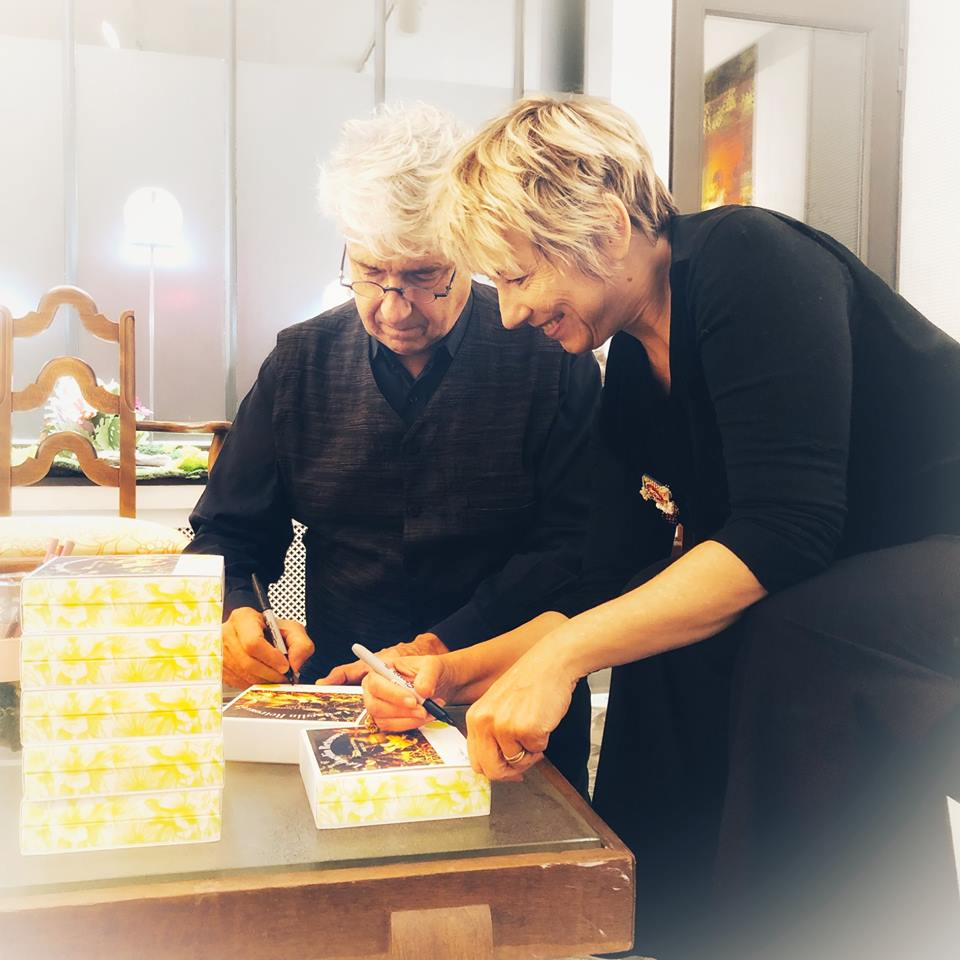 Michel and Clara signing perfume boxes