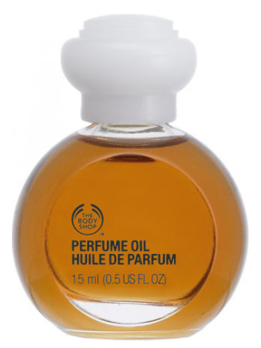 Woody Sandalwood Perfume Oil The Body Shop for women and men